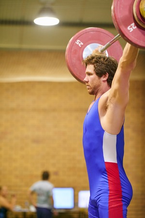 jerk: A weight lifter lifting weights during a competition Stock Photo