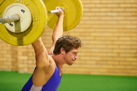 weight lifter: A weight lifter lifting weights during a competition Stock Photo