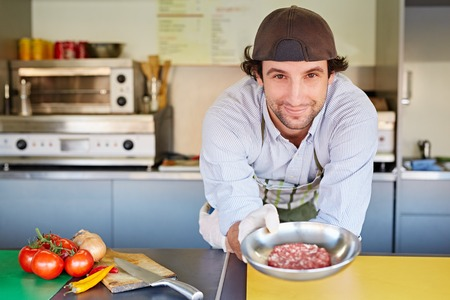 entrepeneur: Food entrepeneur holding a bowl of good quality red meat, minced for making hamburger patties
