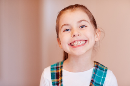smug: A cute little girl smiling at the camera