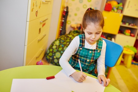 drawing room: A little girl drawing  in her room Stock Photo