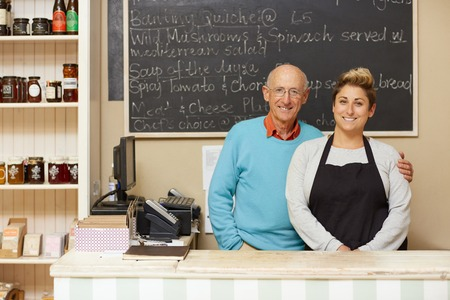 deli: Two deli business owners behind the counter