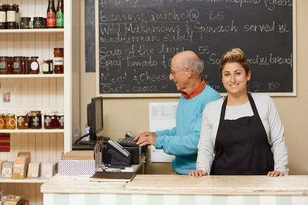 Two small business owners behind the deli counter Banque d'images