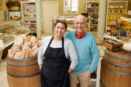 A father and daugther standing together in their deli Stock Photo - 57155121