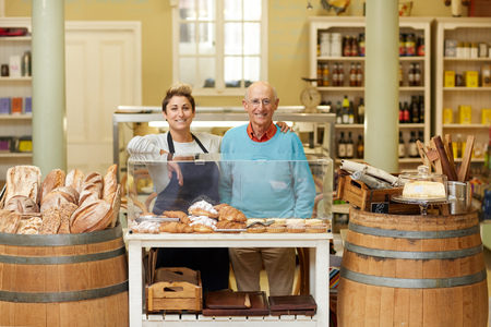daugther: A father and daugther standing together in their deli