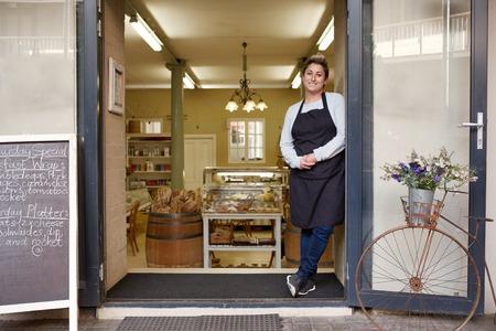 Deli: A young female deli employee standing in the doorway