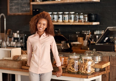 Portrait of an attractive young woman working in a cafe