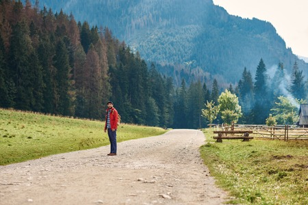 Young man standing on a path in the great outdoors