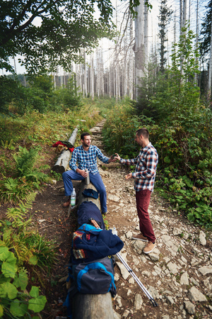Hikers resting during a hike in the forest Stock Photo