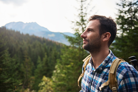 one young man: Hiker admiring the view high up in the hills