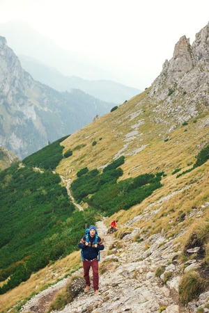 Hikers making their way up a rugged mountain trail