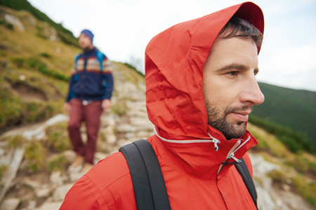 Hiker surveying the landscape with a friend behind him Stock Photo