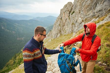 Hikers preparing for the walk back down a mountain 版權商用圖片
