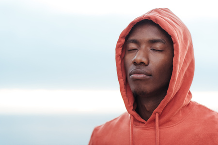 Young African man getting focused before going for a run