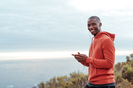 Smiling African man listening to music before a run 版權商用圖片