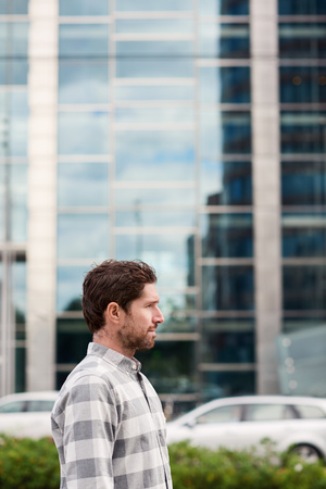 Young man standing in front of buildings in the city Stock Photo