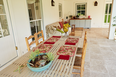 Exterior dining table on the patio of a country home