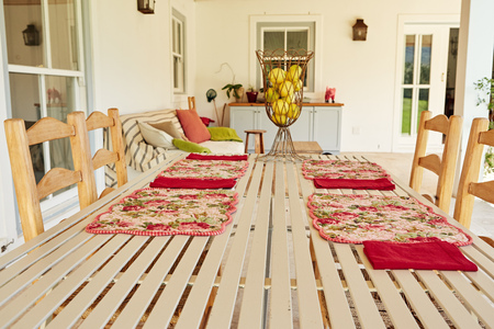 Dining table on the porch of a comfortable country home