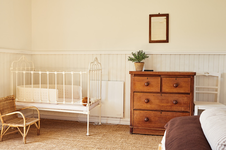 Cot in the comfortable bedroom of a country home Banco de Imagens