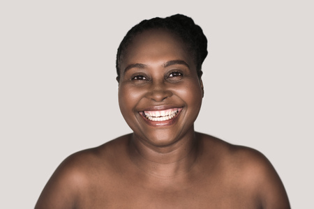 Young African woman with perfect skin and a big smile Stok Fotoğraf