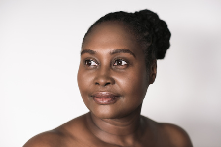 Young African woman with beautiful skin against a white background