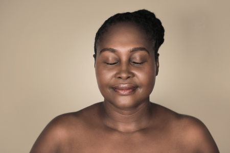 African woman with her eyes closed and a beautiful complexion