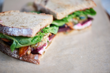 Delicious gourment sandwich of mixed vegetables on a serving board