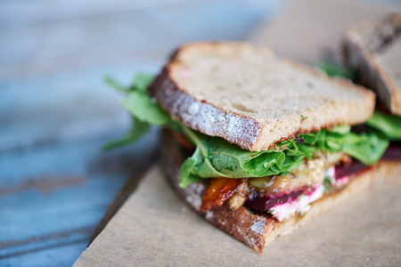 Delicious artisinal sandwich of mixed vegetables on a wooden table