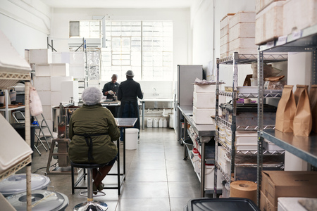 People working in a small artisanal chocolate making factory Reklamní fotografie