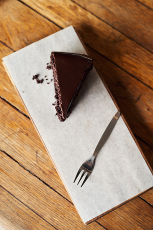 Delicious slice of chocolate cake sitting on a cafe table