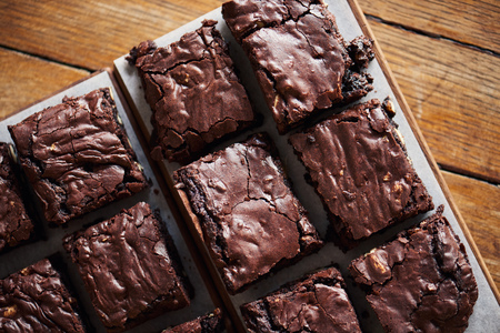 Stacks of homemade chocolate brownies sitting on a cafe table