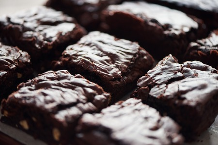 Homemade chocolate brownies sittiing on a bakery counter