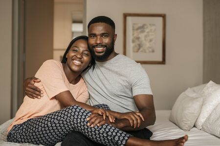 African American couple sitting on their bed in the morning 写真素材