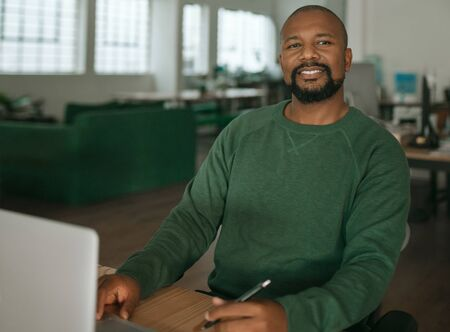 Content African American designer working at his office desk