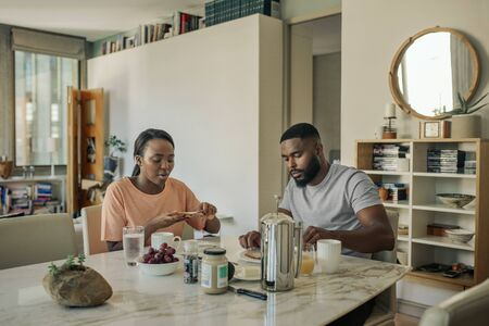 Young African American couple having breakfast in the morning