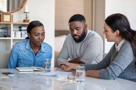 Financial planner going over documents with an African American couple
