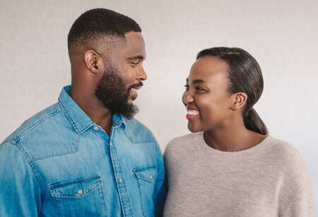 Young African American couple laughing together at home