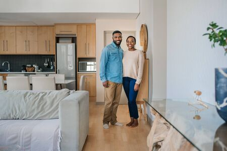 Smiling African American couple standing together at home