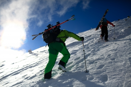 Two skiers climb a mountain Hoverla  Ukraine, Carpathian Mountains  Then they will go backcoutry skiing