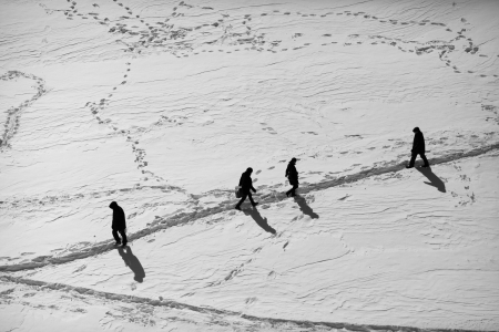people walking on the snowy trail photo