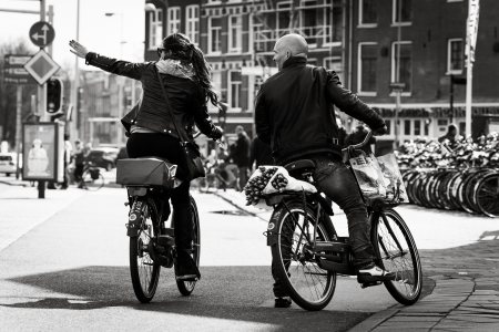man and woman on the bikes on the street. Black and white. Netherlands, Amsterdam