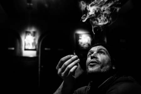 man smokes marijuana in a coffeeshop. Black and white. Netherlands, Amsterdam  Éditoriale