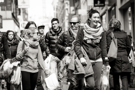 smiling woman in the crowd on the street. Black and white. Netherlands, Amsterdam