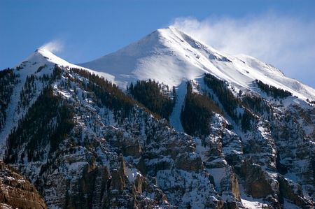 capped: snow blowing of snow capped peaks