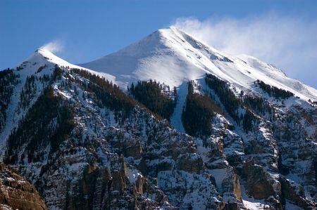 snow blowing of snow capped peaks