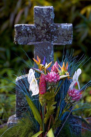 tombstone with floral arrangement