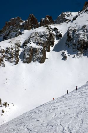 off piste: skier on cell phone off piste in san juan mountains