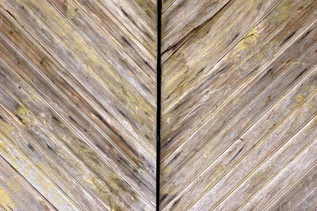 patina: angled wood panelled garged doors with aged patina