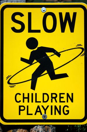Slow Children Playing sign modified with hula hoop