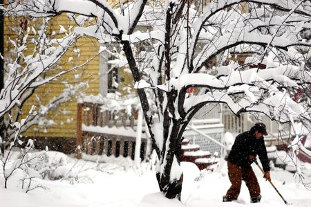 man shovelling snow on winter day